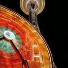Picture - Seattle Space Needle with ferris wheel at night.