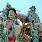 Picture - Statues on the roof of the Sri Mariamman Hindu temple in Singapore.