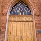 Picture - Gothic style entrance with stained glass, St Ignatius, Montana.