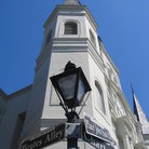 Picture - Lamp post and sign in front of the St Louis Cathedral in New Orleans.