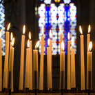 Picture - Candles inside St Peter's Church in Leuven.
