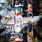 Picture - Totem poles on display in Stanley Park in Vancouver.