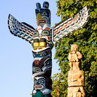 Picture - Northwest coast native totem poles in Stanley Park, Vancouver.