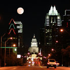 Picture - Looking down a street at night in Austin to the Texas State Capitol building.