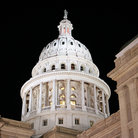 Picture - Texas State Capitol building dome lit up at night in Austin.