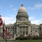 Picture - American flag in front of the State Capitol building in Boise.