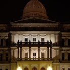 Picture - Lansing State Capitol building at night.