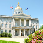Picture - Front view of the State House in Concord.