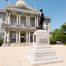 Picture - The statue of Daniel Webster in front of the State House in Concord.