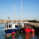 Picture - Boast in the harbor at Stonehaven.