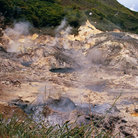 Picture - Steam erupts from the Sulphur Springs volcanic park near Soufrière.