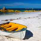 Picture - A rowboat on a white sand beach in Tasmania.