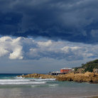 Picture - Dark cloud over Tathra Bay.