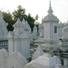 Picture - Whitewashed Lanna stupas.