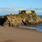 Picture - Old building on a rocky outcropping at Tenby.