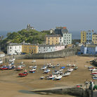Picture - Boats on the shore at Tenby harbor.