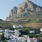 Picture - A typical Greek island villagebelow the Xobourgo rock in Tinos.