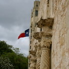 Picture - Columns of the Alamo with a Texas Flag, San Antonio.