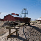 Picture - A mine car, hoist and building in the desert at Tonopah.