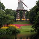 Picture - Windmill on Moat Wallanlagen seen from Herdentorsteinweg Bridge in Bremen.