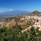 Picture - View over the city of Taormina with Mt Etna in behind.