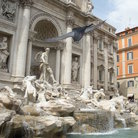 Picture - A bird approaching the statue of Neptune in the Trevi Fountain in Rome.