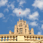 Picture - Flags flying from the top of the Tribune Tower in Chicago.