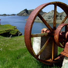 Picture - Rusty equipment and scenic view from Twillingate Island.