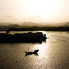 Picture - Sunset over the lake palace at Udaipur.