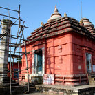 Picture - A red Jain temple at the Khandagiri & Udaigiri caves at Bhubaneshwar city.