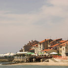 Picture - Old stone buildings along the ocean front at Umag.