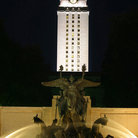 Picture - Tower lit at night at the University of Texas in Austin.