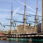 Picture - Museum ship USS Constellation against the skyline of Baltimore.