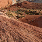 Picture - Rolling hills of rock and sand in the Valley of Fire State Park.
