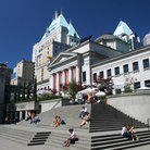 Picture - People enjoying a sunny day on the stairs of the Vancouver Art Gallery.
