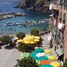 Picture - Umbrellas near the waterfront in Vernazza.
