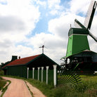 Picture - A green windmill in Volendam.
