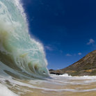 Picture - Wave breaking on a beach at Waimea.