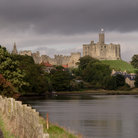 Picture - Warkworth Castle sits atop a hill.