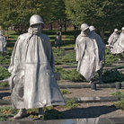 Picture - Statues stand among the shrubs at the Korean War Memorial in Washington.