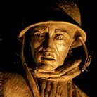 Picture - Face of a statue from the Korean War Memorial in Washington at night.