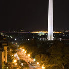 Picture - Street lights at night in front of the Washington Monument.