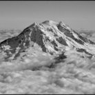 Picture - Aerial view of Mount Rainier with clouds.