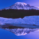 Picture - Mount Rainier reflecting in the calm water with snow.
