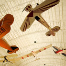 Picture - The Spirit of St Louis and the Wright Brothers' planes hang above the crowd at the Air and Space Museum, Washington.