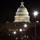 Picture - Street and Capitol building dome in Washington, at night.