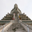 Picture - Wat Arun (Temple of Dawn) stands 82 meters tall across the river from Bangkok.