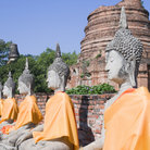 Picture - Row of Buddha statues at the temple of Wat Yai Chai Mongkol in Ayutthaya near Bangkok.
