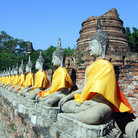 Picture - Row of Buddhas at the temple of Wat Yai Chai Mongkol in Ayutthaya.