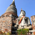 Picture - Buddha and temple top at Wat Yai Chai Mongkol in Ayutthaya.